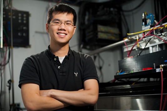 Will Chueh standing in front of lab equipment